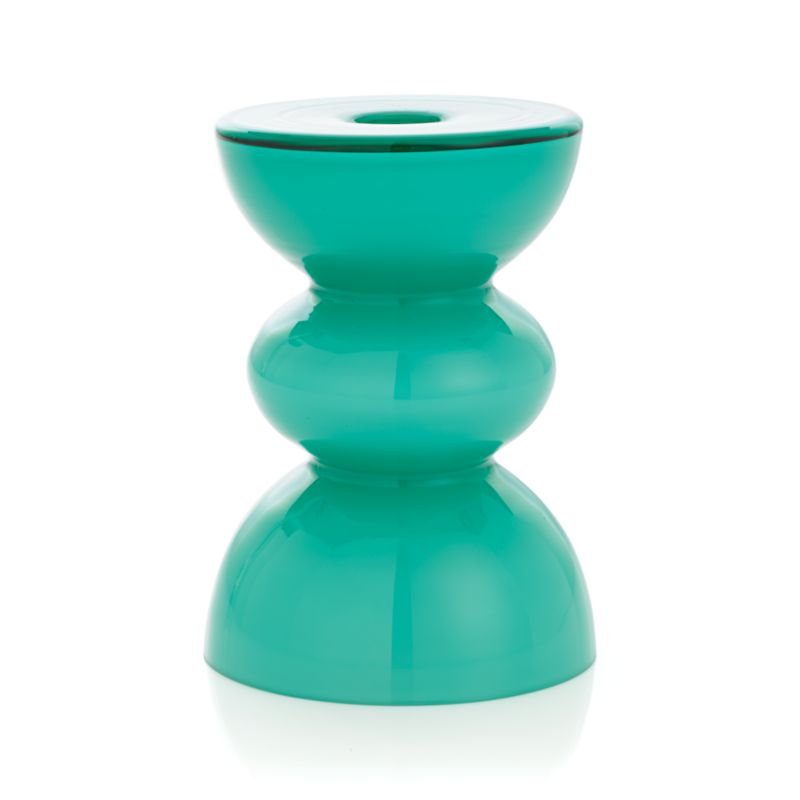 "Celadon curves of milky glass ebb and flow in a well-turned, artisan-crafted candleholder. Luminous on its own or couple with its companion large candleholder for a sea-inspired pairing.<br /><br /><NEWTAG/><ul><li>Handmade glass</li><li>Accommodates up to 3""-dia. pillar candle, sold separately</li><li>Dust with soft dry cloth</li><li>Made in China</li></ul>"