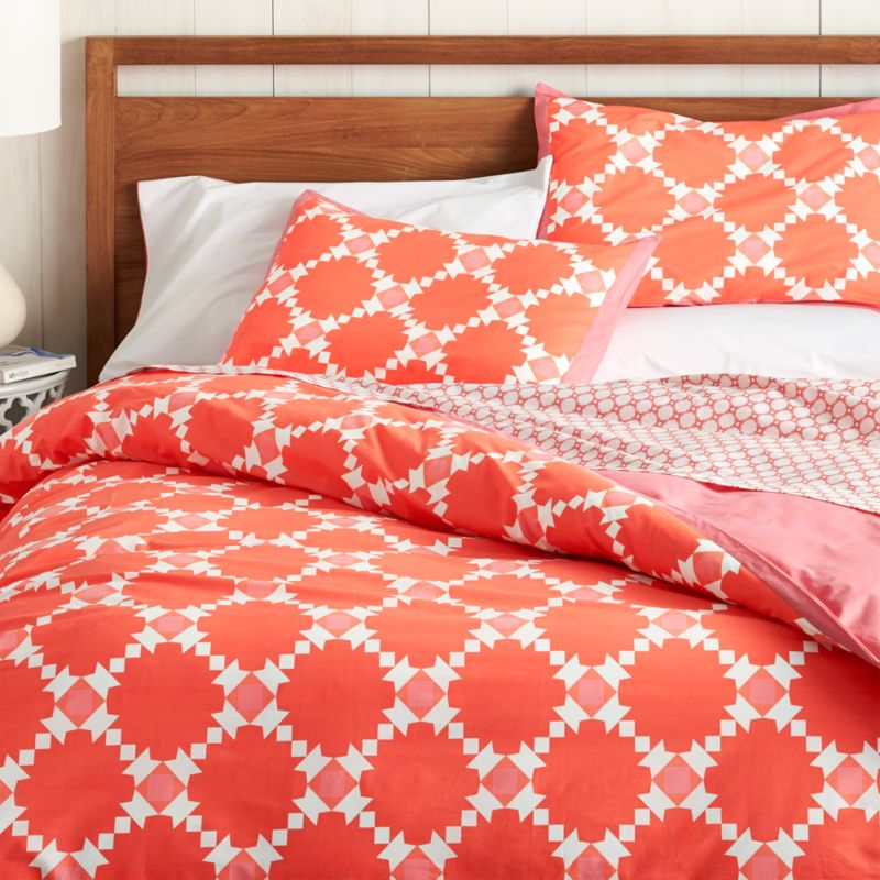 Classic geometric quilting pattern updates in sunny coral and white as a sunny, streamlined graphic by London designer Genevieve Bennett, printed on soft cotton percale. Duvet reverses to solid coral pastel and has a hidden button closure and interior fabric ties to keep things tidy. Bold pattern pairs beautifully with scaled-down motif of coordinating Genevieve bed sheets. Duvet inserts also available.<br /><br /><NEWTAG/><ul><li>Designed by Genevieve Bennett</li><li>100% cotton percale</li><li>200-thread-count</li><li>Hidden button closure and interior fabric ties</li><li>Machine wash cold, tumble dry low; warm iron as needed</li><li>Made in Portugal</li></ul>