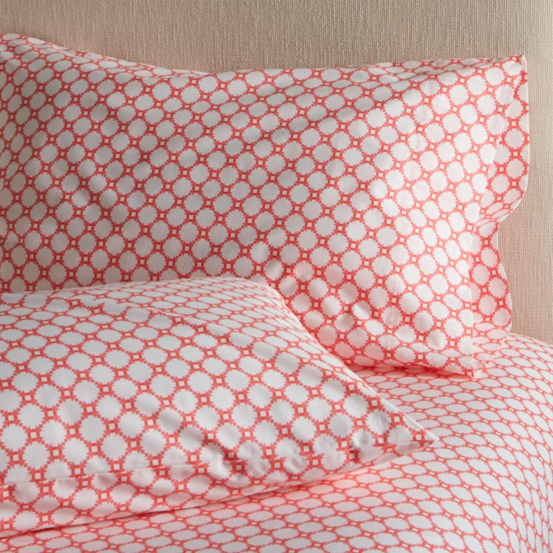 Classic geometric quilting pattern updates in sunny coral and white as a sunny, streamlined graphic by London designer Genevieve Bennett, printed on soft cotton percale. Scaled-down motif coordinates beautifully with boldly patterned Genevieve bed linens. Bed pillows also available.<br /><br /><NEWTAG/><ul><li>Designed by Genevieve Bennett</li><li>100% cotton percale</li><li>200-thread-count</li><li>Machine wash cold, tumble dry low; warm iron as needed</li><li>Made in Portugal</li></ul><br />