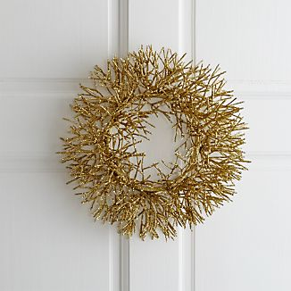 Petite wreath sparkles a plenty, glittering gold on the door or encircling a pillar candle. Beautifully surrounds a three-inch pillar candle.