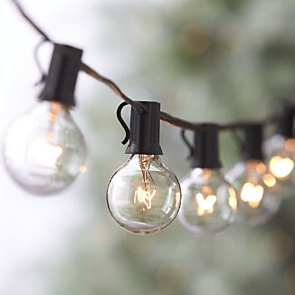 Indoor-outdoor lights with clear, easy-to-replace mini globes light up trees and shrubbery for the holidays and illuminate your surroundings all year long.Need some ideas? Check out our outdoor lighting inspiration.