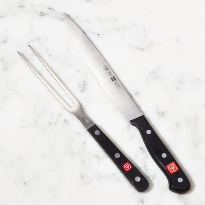 Wusthof Gourmet Carving Set is ultimate in carving precision. Carving knife features a strong, long-lasting blade that will hold its edge and maintain its shape. High-impact synthetic handles on knife and fork are comfortable to hold, more durable and sanitary than wood.<br /><br /><a href=/shop-by-brand/wusthof/1> View all Wüsthof products</a><br /><br /><a href=/Gift-Registry/Registrant/Promo-Bonus-Gifts.aspx> Wüsthof and other Wedding Registry offers</a><br /><br /><NEWTAG/><ul><li>High-carbon, no-stain laser-cut stamped blade is easy to sharpen</li><li>Full tang holds the blade in place, adding weight and balance</li><li>Tempered and hardened steel with a V-ground edge</li><li>Blade has a 14 degree edge angle</li><li>Synthetic handles</li><li>Well balanced</li><li>Hand washing recommended</li><li>Made in Germany</li></ul>