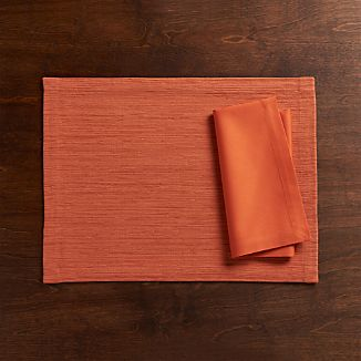 Grasscloth Coral Placemat and Fete Coral Napkin