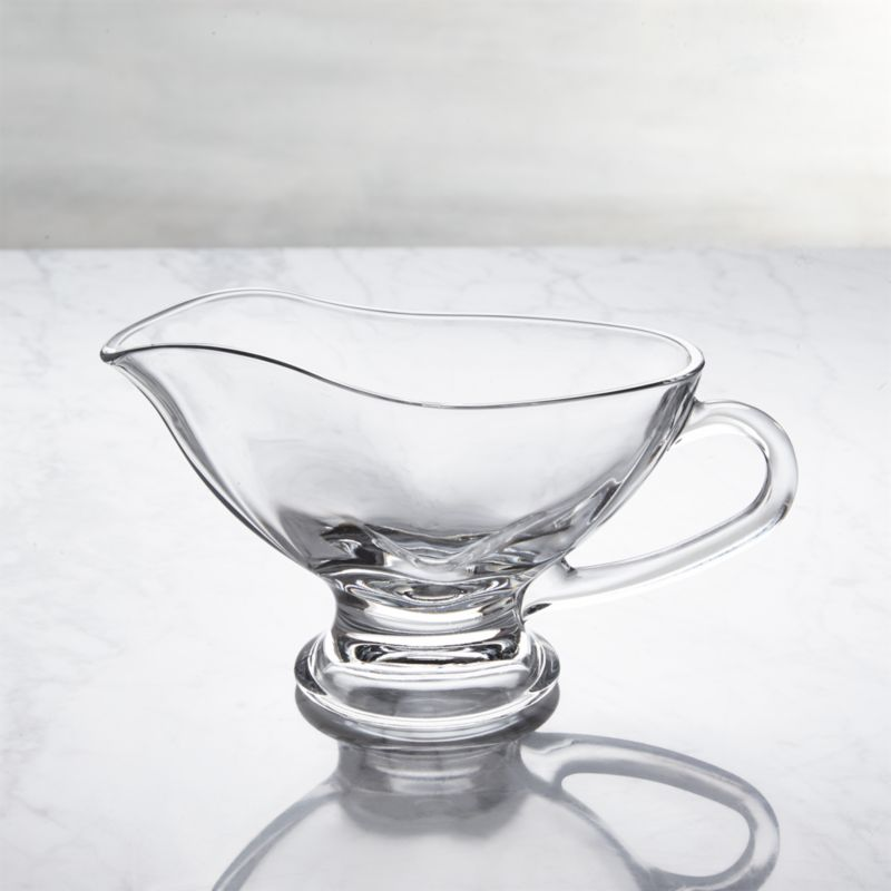 Graceful footed gravy boat serves gravy, cheese sauce, hot fudge and more to the whole crowd.<br /><br /><NEWTAG/><ul><li>Soda lime glass</li><li>Dishwasher-safe</li><li>Made in Turkey</li></ul>