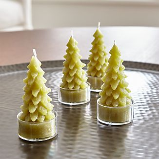 A classic holiday candle shows off beautiful shape and detailing. Each looks stately on its own. But you can also create your own evergreen forest, clustering several pine tree tealights together.