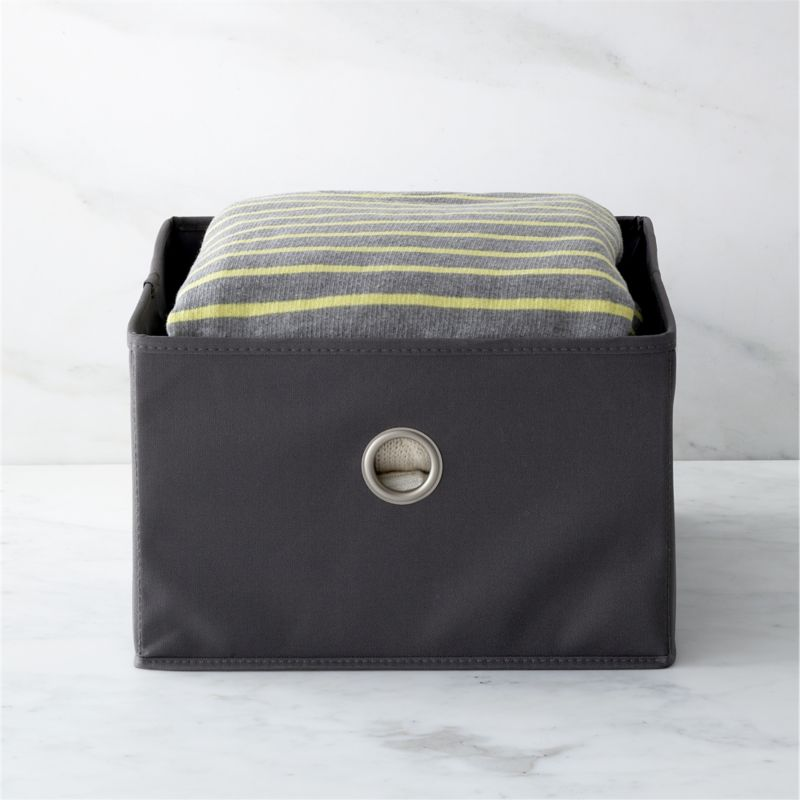 Sweater drawer in grey with nickel-plated grommet neatly stows clothing of all kinds in our coordinating hanging sweater bag. Drawer folds flat for storage when not in use.<br /><br /><NEWTAG/><ul><li>Heavy-duty polyester and cardboard</li><li>Satin nickel plated grommet</li><li>Clean with a damp cloth</li><li>Made in China</li></ul><br />