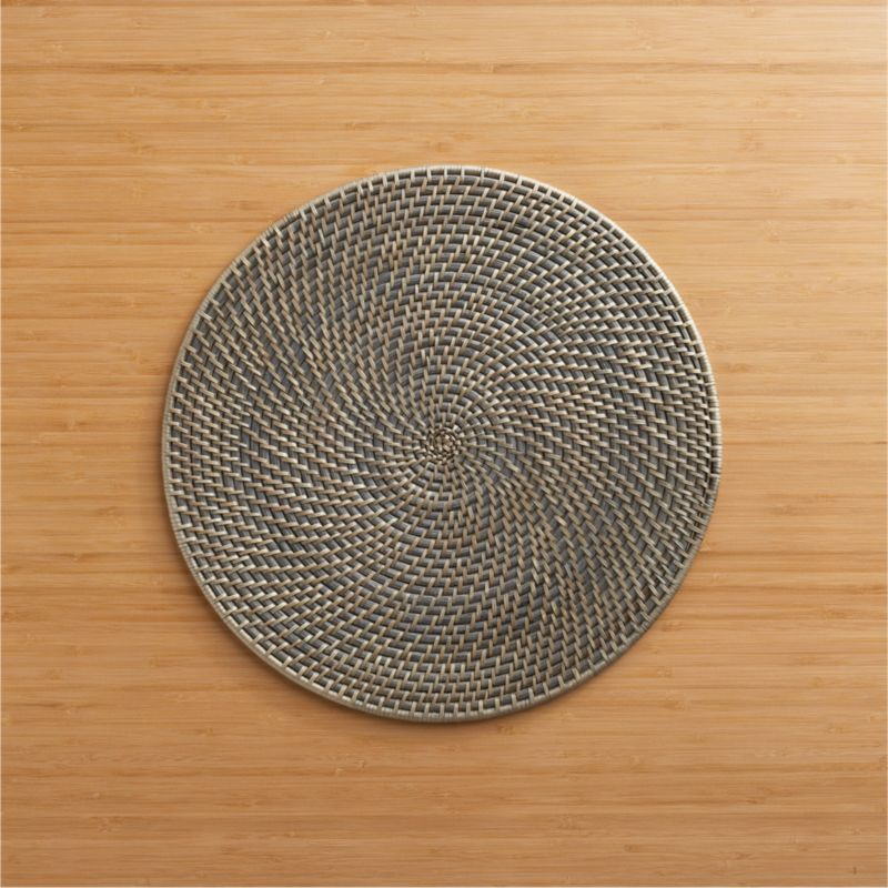 Intricately woven with natural and grey tones of rattan fiber, this decorative and functional round placemat has a sophisticated, organic appeal.<br /><br /><NEWTAG/><ul><li>100% rattan with water-based paint</li><li>Clean placemat with a damp cloth</li><li>Made in The Philippines</li></ul>