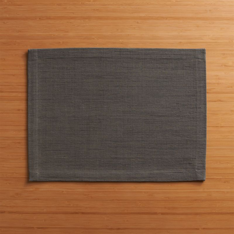 Rich hand-dyed colors in subtle tone-on-tone grey hues are hand-dyed and -woven into a grasscloth-textured placemat.<br /><br /><NEWTAG/><ul><li>Handcrafted</li><li>98% cotton and 2% fiber</li><li>Oversized to allow for shrinkage</li><li>Machine wash warm, dry flat; iron as needed</li><li>Made in India</li></ul>