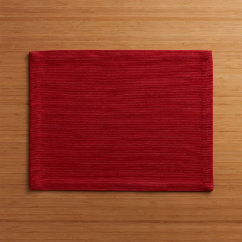 Rich hand-dyed colors in subtle tone-on-tone red hues are hand-dyed and -woven into a grasscloth-textured placemat.<br /><br /><NEWTAG/><ul><li>Handcrafted</li><li>98% cotton and 2% fiber</li><li>Oversized to allow for shrinkage</li><li>Machine wash warm, dry flat; iron as needed</li><li>Made in India</li></ul>