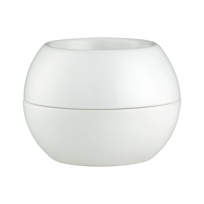 Sculptural double-walled planter in neutral stoneware blurs the boundaries between pot and saucer with its modern nested design. Deep saucer catches residual water for indoor or outdoor planting.<br /><br /><NEWTAG/><ul><li>Glazed stoneware</li><li>Hand wash</li><li>Made in China</li></ul>