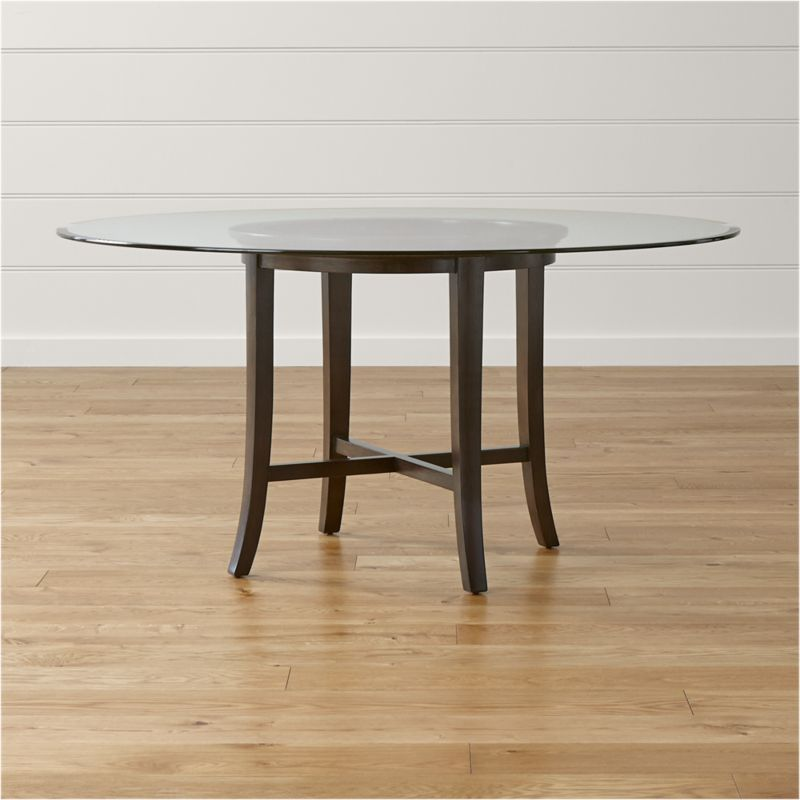"With its distinctive ""halo"" effect, this striking table features a flat glass top with a deep, light-refracting reverse bevel that's echoed in the open ring of the solid chestnut wood base. Featuring a cross brace and slightly flared legs, the table is constructed using traditional wood-on-wood joinery without the use of screws or nails. <NEWTAG/><ul><li>Solid chestnut base with deep ebony finish</li><li>Clear ½""-thick glass top with reverse bevel and polished edge</li><li>BreathingJoinery ™</li><li>Plastic glides</li><li>Seats 6</li><li>Made in China</li></ul>"
