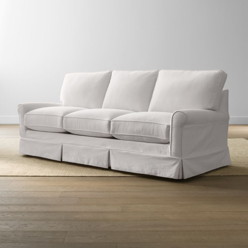 Keep your Harborside queen sleeper sofa looking as fresh as the day you brought it home with this convenient, carefree replacement slipcover. Fitted cotton-blend slipcover is tailored with crisp inverted kick pleats and self-welting to keep it neatly in place. Harborside Queen Sleeper Sofa Replacement Slipcover is a Crate and Barrel exclusive.<br /><br /><NEWTAG/><ul><li>Removable slipcover is machine washable</li><li>Self-welting</li><li>Made in North Carolina, USA</li></ul>