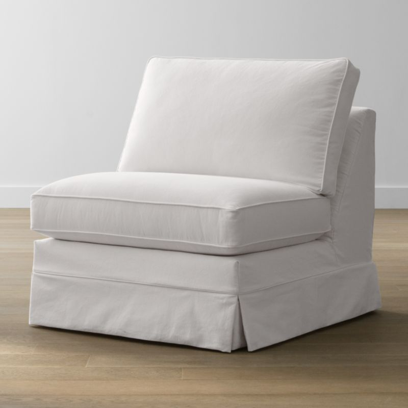 Keep your Harborside sectional armless chair looking as fresh as the day you brought it home with this convenient, carefree replacement slipcover. Fitted cotton-blend slipcover is tailored with crisp inverted kick pleats and self-welting to keep it neatly in place. Harborside Armless Chair Replacement Slipcover is a Crate and Barrel exclusive.<br /><br /><NEWTAG/><ul><li>Removable slipcover is machine washable</li><li>Self-welting</li><li>Made in North Carolina, USA of domestic and imported materials</li></ul>