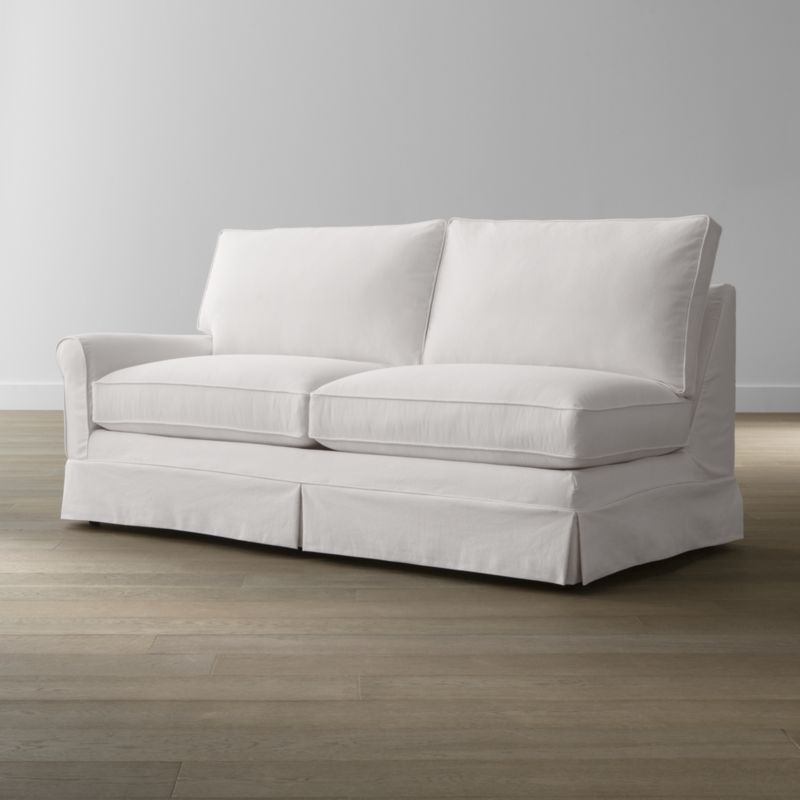 Keep your Harborside sectional left arm full sleeper sofa looking as fresh as the day you brought it home with this convenient, carefree replacement slipcover. Fitted cotton-blend slipcover is tailored with crisp inverted kick pleats and self-welting to keep it neatly in place. Harborside Left Arm Full Sleeper Sofa Replacement Slipcover is a Crate and Barrel exclusive.<br /><br /><NEWTAG/><ul><li>Removable slipcover is machine washable</li><li>Self-welting</li><li>Made in North Carolina, USA of domestic and imported materials</li></ul>