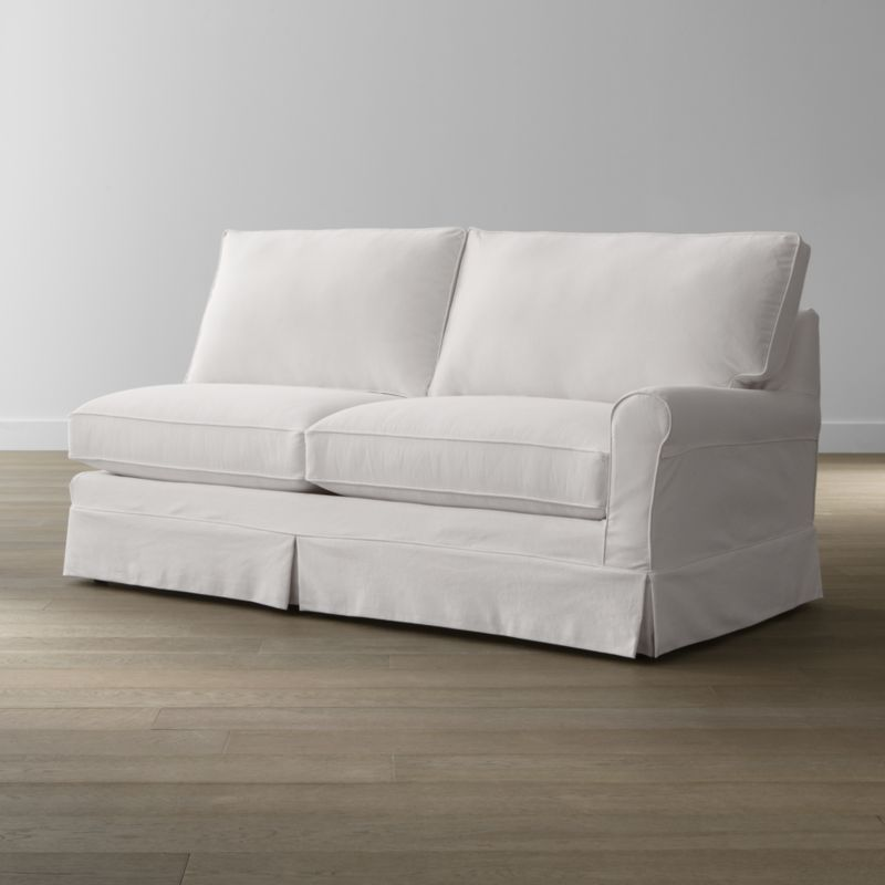 Keep your Harborside sectional right arm sofa looking as fresh as the day you brought it home with this convenient, carefree replacement slipcover. Fitted cotton-blend slipcover is tailored with crisp inverted kick pleats and self-welting to keep it neatly in place. Harborside Right Arm Sofa Replacement Slipcover is a Crate and Barrel exclusive.<br /><br /><NEWTAG/><ul><li>Removable slipcover is machine washable</li><li>Self-welting</li><li>Made in North Carolina, USA of domestic and imported materials</li></ul>