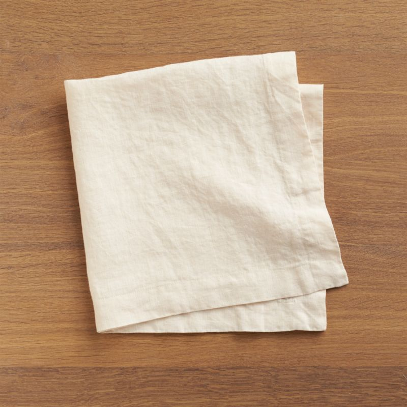 "Lightweight 100% linen cloth napkin unfolds to a generous 22"" square in natural ivory, pre-washed for extra softness. Tailor finished dinner napkin has a 1.5"" hem and mitered corners.<br /><br /><NEWTAG/><ul><li>100% linen</li><li>Dry clean or machine wash cold separately on gentle cycle, do not bleach</li><li>Tumble dry low</li><li>Warm iron as needed</li><li>Made in India</li></ul>"