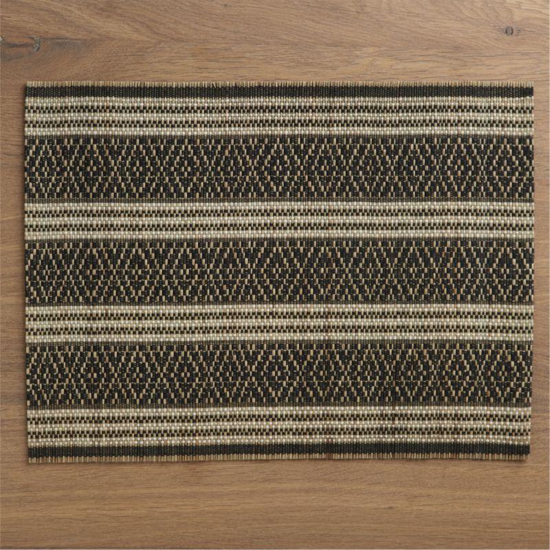 Black threads are handwoven over mendong fiber slats to create a graphic, geometric diamond pattern with modern, ethnic flair. Placemat rolls  up for easy storage.<br /><br /><NEWTAG/><ul><li>Handwoven</li><li>90% mendong and 10% thread</li><li>Wipe with damp cloth</li><li>Made in Indonesia</li></ul>