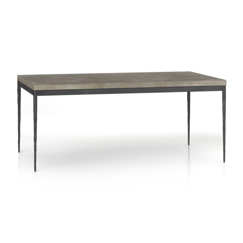 "You've designed your ideal table, from top to bottom in just the right size. The warm grey concrete top is a mix of marble, stone and granite powders with natural fibers for added strength. This industrial, modern surface is handmade in an eco-friendly shop powered without fossil fuels. Due to the handmade nature of the concrete mix, color will vary and may change over time. Slim tapered legs accentuate the graceful profile of the steel base, hammered to resemble artisanal metalsmithing. A dark finish and a protective top coat enhance its sculptural appeal. Generously sized table is great for entertaining, seating up to 8. The Concrete Top/Hammered Base 72""x42"" Dining Table is a Crate and Barrel exclusive.<br /><br /><NEWTAG/><ul><li>Handmade concrete top of stone, marble, granite and natural fibers</li><li>Hairline fractures and slight tolerance for fit to base are characteristics of the concrete</li><li>Steel base with dark finish and clear polyurethane topcoat</li><li>Levelers</li><li>Seats 8</li><li>Made in Vietnam</li></ul>"