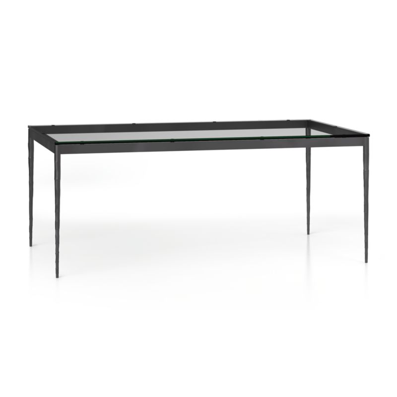 "You've designed your ideal table, from top to bottom in just the right size. Clear float glass makes a transparent top that's ⅝-inch thick with a flat, polished edge. Slim tapered legs accentuate the graceful profile of the steel base, hammered to resemble artisanal metalsmithing. A dark finish and a protective top coat enhance its sculptural appeal. Generously sized table is great for entertaining, seating up to 8. The Clear Glass Top/Hammered Base 72""x42"" Dining Table is a Crate and Barrel exclusive.<br /><br /><NEWTAG/><ul><li>⅝"" glass top with flat polished edge</li><li>Non-tempered glass</li><li>Steel base with dark finish and clear polyurethane topcoat</li><li>Seats 8</li><li>Made in China and Vietnam</li></ul>"