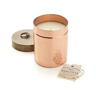 Hammered copper-plated canister, with its hand-stamped cotton hangtag, is reminiscent of sugar and flour containers found in old-time mercantile stores. Its textured surface, warm color and sentimental fragrances stir up warm memories of times past. Ambrosia fragrance mixes essences of orange and coconut with a dash of grapefruit.