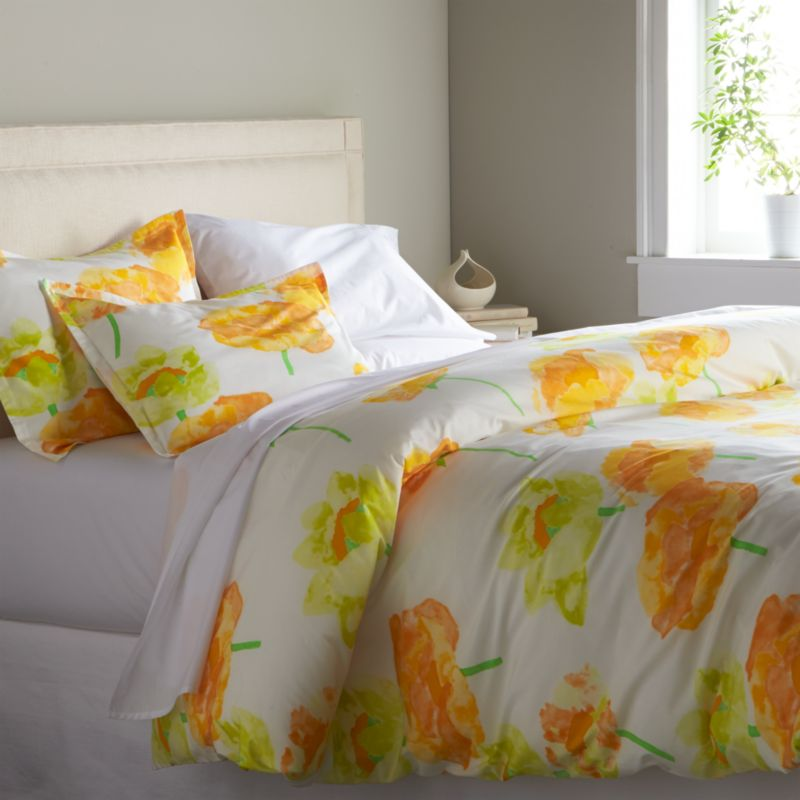 Orange and citron poppies bloom outsize and ethereal on crisp white cotton percale, rendered in watercolor washes and artful brushstrokes. Designed by Fujiwo Ishimoto this exuberant pattern is an outstanding example of the designer's abstract perspective on nature's beauty. Duvet has a hidden button closure and interior ties to keep the insert in place. Duvet inserts also available.<br /><br /><NEWTAG/><ul><li>Designed by Fujiwo Ishimoto</li><li>100% cotton percale</li><li>300-thread count</li><li>Button closure</li><li>Interior fabric ties</li><li>Machine wash cold; tumble dry low; warm iron as needed</li><li>Made in Pakistan</li></ul>