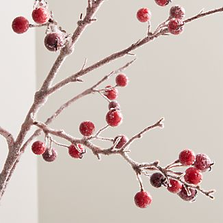 Red berries gloss with an icy glaze on a naturalistic branch that adds an organic, wintery note to holiday décor.