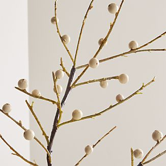 Delicate white berries dot branching stem of faux ilex. Lifelike accent piece brings nature's winter finery indoors.
