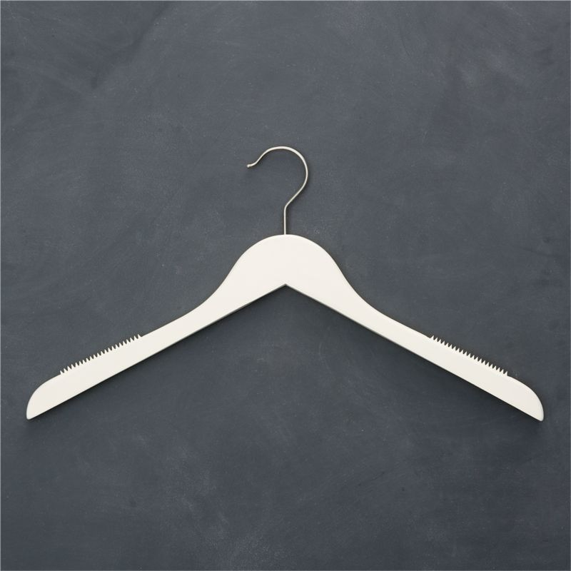 For a closet you can take pride in, quality maple hangers painted matte ivory replace mismatched hangers with a clean, cohesive look. Nonslip shoulder inserts retain slippery garments without puckering; satin-finish hook swivels for convenience.<br /><br /><NEWTAG/><ul><li>Painted maple with stainless steel bar and clips</li><li>Clear matte lacquer finish</li><li>Rubber non-slip shoulder inserts</li><li>Satin stainless steel swivel hook</li><li>Clean with a damp cloth</li><li>Made in China</li></ul>
