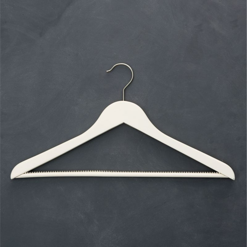 For a closet you can take pride in, quality maple hangers painted matte ivory replace mismatched hangers with a clean, cohesive look. Nonslip bar and shoulder inserts retain slippery garments without puckering; satin-finish hook swivels for convenience.<br /><br /><NEWTAG/><ul><li>Painted maple with stainless steel bar and clips</li><li>Clear matte lacquer finish</li><li>Rubber non-slip bar and shoulder inserts</li><li>Satin stainless steel swivel hook</li><li>Clean with a damp cloth</li><li>Made in China</li></ul>