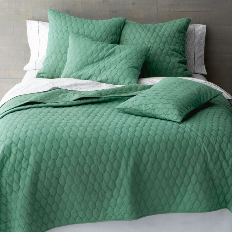 Trellis-stitched quilt textures an expanse of deep, majestic jade with soft honeycombed puckers and the organic feel of 100% cotton. Woven jacquard front reverses to silky voile. Gorgeous on its own, Jade layers beautifully with prints and contrasting solid or textured fabrics.<br /><br /><NEWTAG/><ul><li>100% cotton jacquard</li><li>Reverses to 100% cotton voile</li><li>100% polyester fill</li><li>Machine wash, gentle cycle; tumble dry low</li><li>Made in India</li></ul>