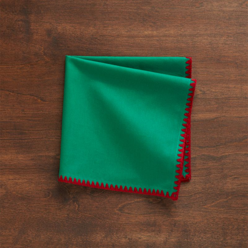 Bold red serging adds a perky edge of color to deep green cotton napkin.<br /><br /><NEWTAG/><ul><li>100% cotton</li><li>Machine wash cold, dry flat; warm iron as needed</li><li>Made in India</li></ul>