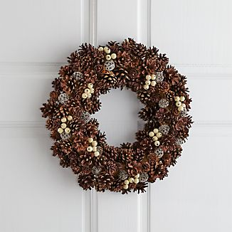 Pinecones take on just the right amount of sparkle to make this nature-derived wreath extra festive. Pods and faux white berries add a bit of color and textural interest. Small pinecone wreath beautifully surrounds a 3 inch pillar candle.
