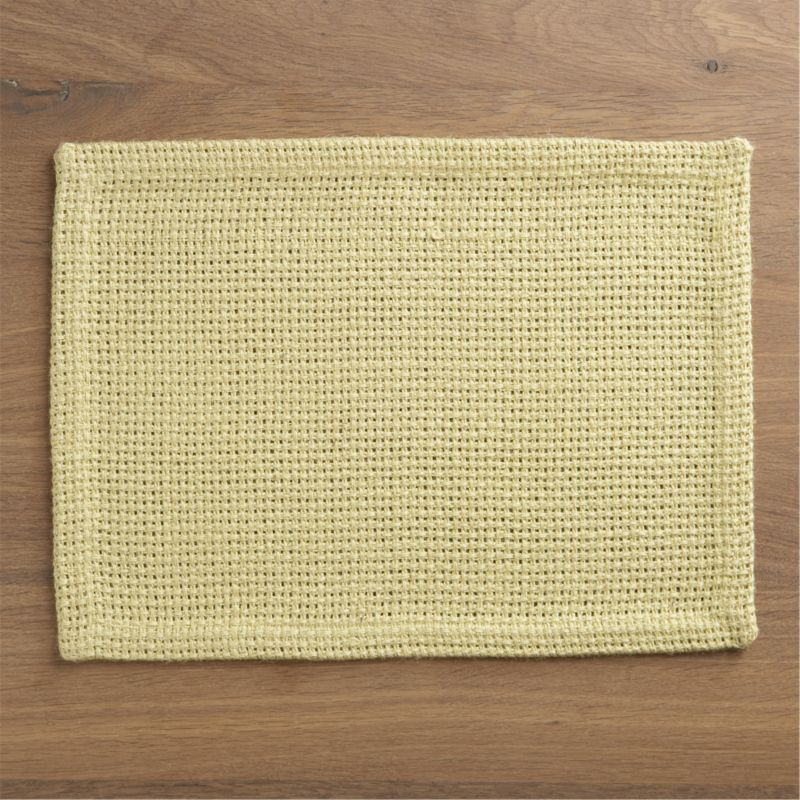 Tactile, beautiful jute shows off in a chunky, open weave placemat, setting a textural, solid yellow base for a range of colorful place settings.<br /><br /><NEWTAG/><ul><li>100% jute</li><li>Machine wash, dry flat; warm iron as needed</li><li>Made in India</li></ul>