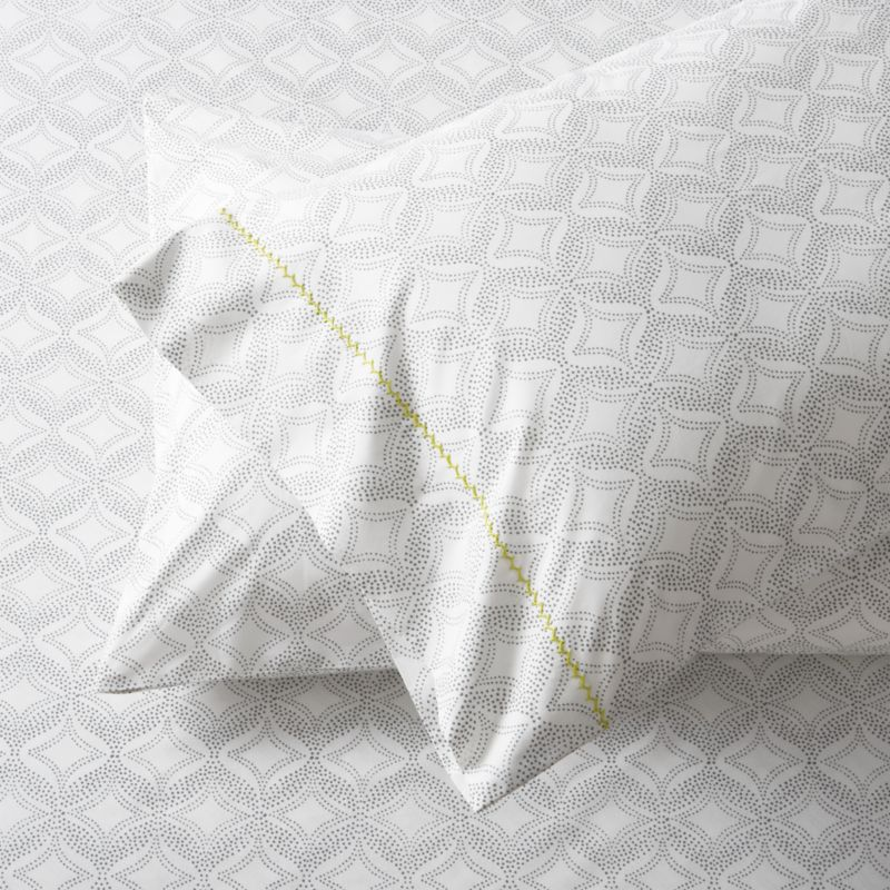 Soft grey patterns a pointillist kaleidoscope, softly understated to layer with solids and other prints. Pillowcases are embellished with single line of hand-embroidered chain stitching. Bed pillows also available.<br /><br /><NEWTAG/><ul><li>100% cotton percale</li><li>200-thread-count</li><li>Machine wash cold, tumble dry; warm iron as needed</li><li>Made in India</li></ul>