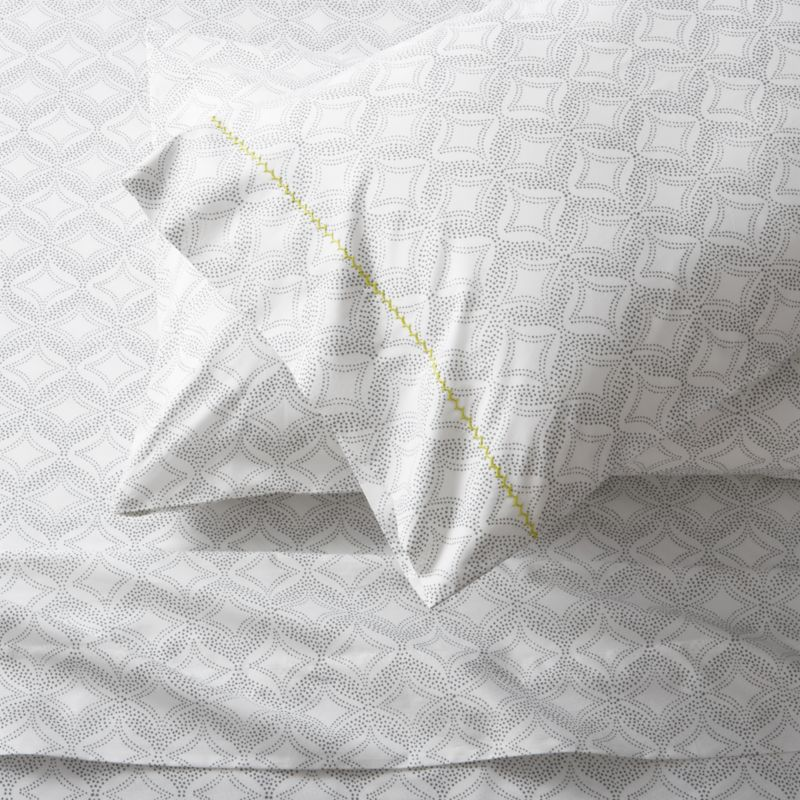 Soft grey patterns a pointillist kaleidoscope, softly understated to layer with solids and other prints. Pillowcases are embellished with single line of hand-embroidered chain stitching. Sheet set includes one flat sheet, one fitted sheet and two king pillowcases. Bed pillows also available.<br /><br /><NEWTAG/><ul><li>100% cotton percale</li><li>200-thread-count</li><li>Machine wash cold, tumble dry; warm iron as needed</li><li>Made in India</li></ul>