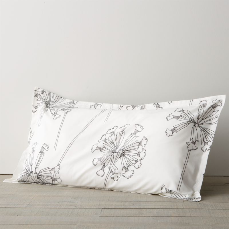 "While perusing an old botanical scrapbook, designer Erja Hirvi was struck by the structure of the cowslip (""Kevatesikko""), a flowering plant common to Europe. Her beautiful line drawings are a celebration of the plant's elegant form and intricate flowers, graphically rendered in black on crisp white. Reversible duvet cover has hidden button closure at bottom and interior fabric ties to hold the insert in place. Pillow sham has 1"" flange and generous overlapping closure. Bed pillows also available.<br /><br /><NEWTAG/><ul><li>Pattern designed by Erja Hirvi; 2011</li><li>100% cotton percale</li><li>300-thread-count</li><li>Machine wash, tumble dry</li><li>Made in Pakistan</li></ul>"
