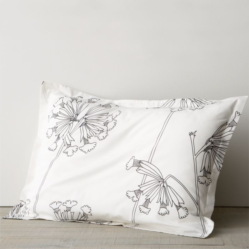 """While perusing an old botanical scrapbook, designer Erja Hirvi was struck by the structure of the cowslip (""""Kevatesikko""""), a flowering plant common to Europe. Her beautiful line drawings are a celebration of the plant's elegant form and intricate flowers, graphically rendered in black on crisp white. Reversible duvet cover has hidden button closure at bottom and interior fabric ties to hold the insert in place. Pillow sham has 1"""" flange and generous overlapping closure. Bed pillows also available.<br /><br /><NEWTAG/><ul><li>Pattern designed by Erja Hirvi; 2011</li><li>100% cotton percale</li><li>300-thread-count</li><li>Machine wash, tumble dry</li><li>Made in Pakistan</li></ul>"""