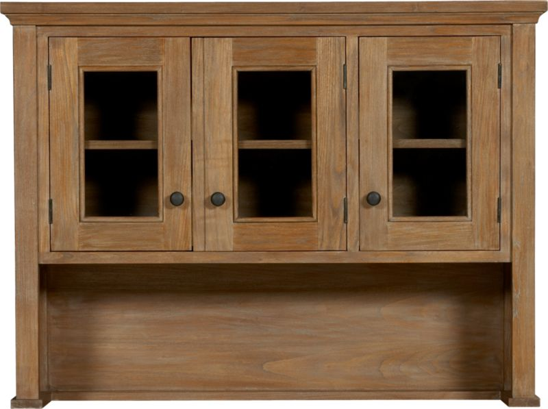 With three glass-paned doors, this full-service piece is a handsome companion to the Kipling dining collection. Doors of fully assembled hutch top open to one fixed shelf for display. Hutch is crafted from solid tropical sungkai wood which is given a grey wash and a soft-sheen lacquer finish. Custom bronze-finish pulls.<br /><br /><NEWTAG/><ul><li>Solid tropical sungkai wood</li><li>Clear protective lacquer finish</li><li>Custom bronze-finish hardware</li><li>Three-door hutch has two fixed shelves, plate groove on base</li><li>Assembly required to attach hutch top to buffet using mending plates and anti-tip hardware (included)</li></ul>