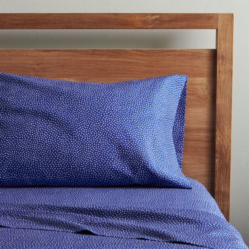 """Tiny white dots trail allover deep dark blue in this pattern by Maija and Kristina Isola patterned after the capricious footsteps of a scampering kitten. The name """"Kiss Kiss"""" refers to the Finnish way of calling a cat.  Luxurious 300-thread-count cotton sheets lay a beautiful foundation to the bed, complementary to all kinds of linens. Sheets and cases are tailored with generous 4"""" hems. Set includes one flat sheet, one fitted sheet and one standard pillow case. Bed pillows also available."""
