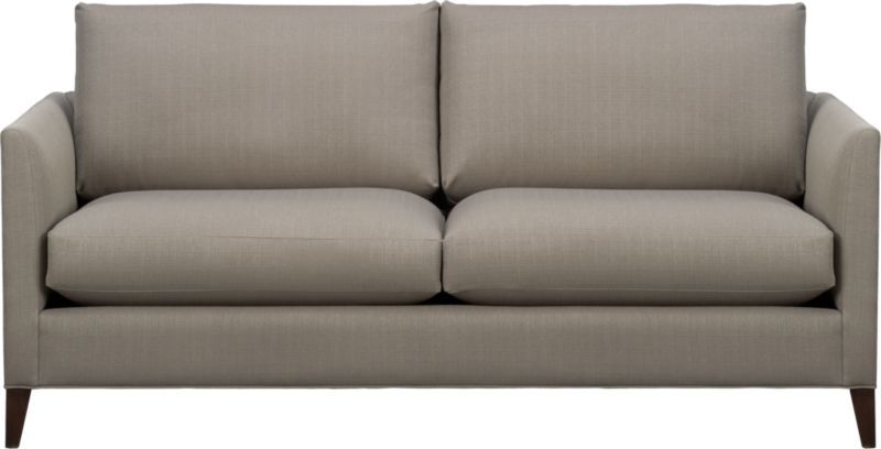 Our Klyne is a compact sofa that fills the room with attitude. Narrow tapered arms cut a sleek profile and make for an even roomier experience. The perfect size for apartment and small space living…or use in conversational pairs for larger spaces.<br /><br />After you place your order, we will send a fabric swatch via next day air for your final approval. We will contact you to verify both your receipt and approval of the fabric swatch before finalizing your order.<br /><br /><NEWTAG/><ul><li>Eco-friendly construction</li><li>Certified sustainable kiln-dried hardwood frame</li><li>Seat cushions are soy- or plant-based polyfoam encased in synthetic ticking</li><li>Back cushions are fiber in synthetic ticking</li><li>Flexolator spring suspension</li><li>Hardwood legs with hickory finish</li><li>Upholstered in polyester</li><li>Benchmade</li><li>See additional frame options below</li><li>Made in North Carolina, USA of domestic and imported materials</li></ul>