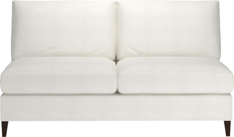 "Tailored to fit our Klyne seating, chic slipcover is fashioned slim and minimal to make the most of its narrow tapered arms, plump cushions and tapered legs.<br /><br />Additional <a href=""http://crateandbarrel.custhelp.com/cgi-bin/crateandbarrel.cfg/php/enduser/crate_answer.php?popup=-1&p_faqid=125&p_sid=DMUxFvPi"">slipcovers</a> available below and through stores featuring our Furniture Collection.<br /><br />After you place your order, we will send a fabric swatch via next day air for your final approval. We will contact you to verify both your receipt and approval of the fabric swatch before finalizing your order.<br /><br /><NEWTAG/><ul><li>89% cotton and 11% polyester</li><li>Machine wash</li><li>Made in North Carolina, USA of domestic and imported materials</li></ul>"