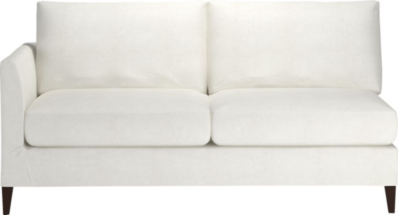 "Klyne is compact seating styled sleek yet roomy, refreshing apartments and small spaces with modern good looks and casual comfort. Chic, tailored slipcover hugs its narrow tapered arms and plump cushions in snowy cotton-poly, with a trim, short skirt to show off its tapered legs.<br /><br />Additional <a href=""http://crateandbarrel.custhelp.com/cgi-bin/crateandbarrel.cfg/php/enduser/crate_answer.php?popup=-1&p_faqid=125&p_sid=DMUxFvPi"">slipcovers</a> available below and through stores featuring our Furniture Collection.<br /><br />After you place your order, we will send a fabric swatch via next day air for your final approval. We will contact you to verify both your receipt and approval of the fabric swatch before finalizing your order.<br /><br /><NEWTAG/><ul><li>Eco-friendly construction</li><li>Certified sustainable kiln-dried hardwood frames</li><li>Seat cushions are soy- or plant-based polyfoam encased in synthetic ticking</li><li>Back cushions are fiber in synthetic ticking</li><li>Flexolator spring suspension</li><li>Hardwood legs with hickory finish</li><li>Slipcover is 89% cotton and 11% polyester</li><li>Machine wash the removable slipcovers</li><li>100% cotton muslin base fabric</li><li>Benchmade</li><li>See additional frame options below</li><li>Made in North Carolina, USA</li></ul>"