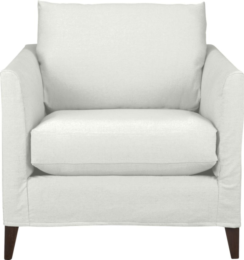 "Klyne is compact seating styled sleek yet roomy, refreshing apartments and small spaces with modern good looks and casual comfort. Chic, tailored slipcover hugs its narrow tapered arms and plump cushions in snowy cotton-poly, with a trim, short skirt to show off its tapered legs.<br /><br />Additional <a href=""http://crateandbarrel.custhelp.com/cgi-bin/crateandbarrel.cfg/php/enduser/crate_answer.php?popup=-1&p_faqid=125&p_sid=DMUxFvPi"">slipcovers</a> available below and through stores featuring our Furniture Collection.<br /><br />After you place your order, we will send a fabric swatch via next day air for your final approval. We will contact you to verify both your receipt and approval of the fabric swatch before finalizing your order.<br /><br /><NEWTAG/><ul><li>Eco-friendly construction</li><li>Certified sustainable kiln-dried hardwood frames</li><li>Seat cushion is soy- or plant-based polyfoam encased in synthetic ticking</li><li>Back cushion is fiber in synthetic ticking</li><li>Flexolator spring suspension</li><li>Hardwood legs with hickory finish</li><li>Slipcover is 89% cotton and 11% polyester</li><li>Machine wash the removable slipcovers</li><li>100% cotton muslin base fabric</li><li>Benchmade</li><li>See additional frame options below</li><li>Made in North Carolina, USA</li></ul>"