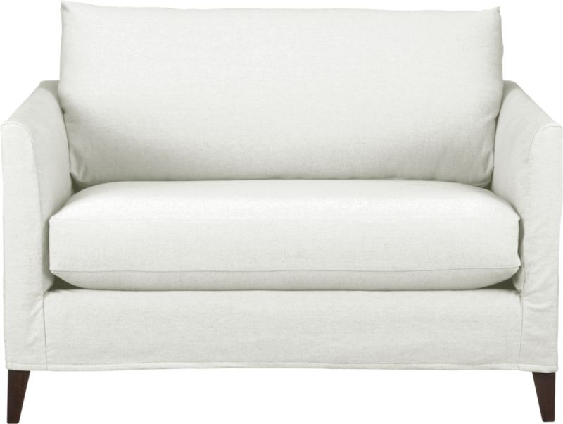 "Tailored to fit our Klyne seating, chic slipcover is fashioned slim and minimal to make the most of its narrow tapered arms, plump cushion and tapered legs.<br /><br />Additional <a href=""http://crateandbarrel.custhelp.com/cgi-bin/crateandbarrel.cfg/php/enduser/crate_answer.php?popup=-1&p_faqid=125&p_sid=DMUxFvPi"">slipcovers</a> available below and through stores featuring our Furniture Collection.<br /><br />After you place your order, we will send a fabric swatch via next day air for your final approval. We will contact you to verify both your receipt and approval of the fabric swatch before finalizing your order.<br /><br /><NEWTAG/><ul><li>89% cotton and 11% polyester</li><li>Machine wash</li><li>Made in North Carolina, USA</li></ul>"