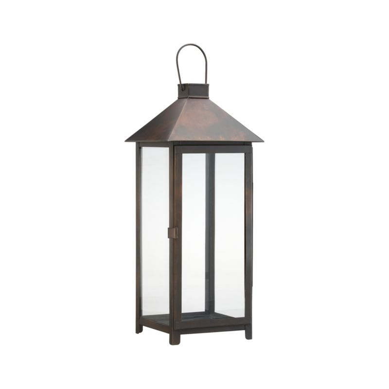 """Clean, oversized styling in antiqued bronze iron with glass panels, hinged door, and hanging handle.<br /><br /><NEWTAG/><ul><li>Glass and iron</li><li>Bronze finish</li><li>For indoor or outdoor use</li><li>Accommodates up to a 4""""-diameter pillar candle, sold separately</li><li>Made in India</li></ul>"""