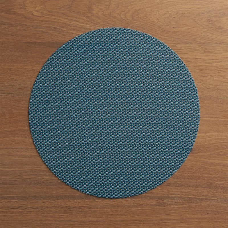Durable polyester-vinyl placemat textures the table in an exclusive pattern that  takes its cue from fine knits.<br /><br /><NEWTAG/><ul><li>Placemat is 70% vinyl and 30% polyester</li><li>Clean placemat with a damp cloth; air or towel dry and store flat</li><li>Made in USA</li></ul>