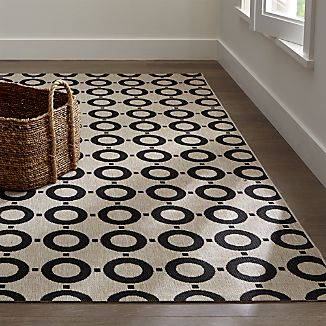 For this clean, modern look, designer Chris Mestdagh went to Greece, taking inspiration from a vintage 1960s iron gate he spied in Athens.  Crafted of polypropylene, this rug is a great choice for indoor or outdoor use as it's stain- and soil-resistant, and UV stable.Order rugs (up to 6'x9') online and pickup in a store near you. It's fast, easy and free.For 8'x10' and larger rugs, order online and arrange a convenient warehouse pickup or delivery.Designed by Chris Mestdagh100% polypropyleneRug pad recommended for indoor useShake, vacuum or hose down to cleanMade in Belgium