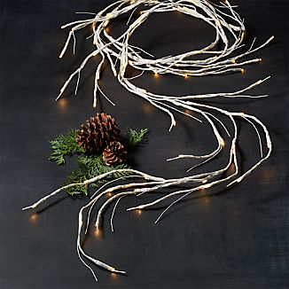 Light up live or faux greenery with a pre-lit LED garland detailed with natural, birch-like patterning. Each battery-operated garland has 72 warm-toned LED bulbs and is fully adjustable along its 10-foot length. No pesky cords and a waterproof battery box means you use it indoors or out.