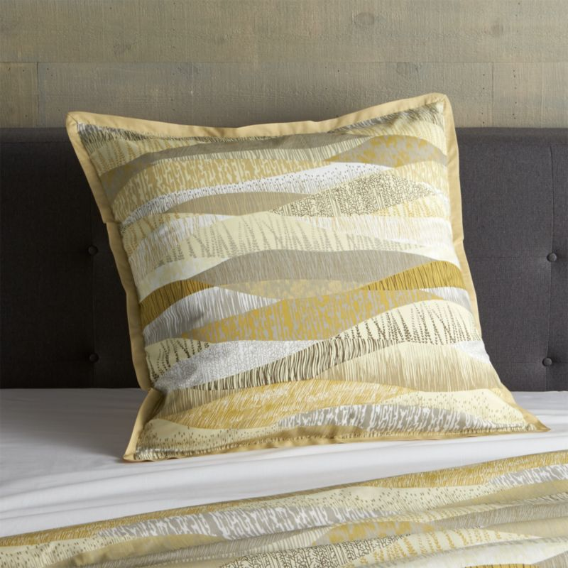 New horizons in tone and texture for the contemporary bed. Flowing landscapes with organic texturing are printed in a rich palette of golds and browns, beiges and greys to resemble an elaborate patchwork quilt. Shams with generous overlapping closures are finished with a slim coordinating flange. Bed pillows also available.<br /><br /><NEWTAG/><ul><li>100% cotton</li><li>180-thread-count</li><li>Machine wash, tumble dry low</li><li>Made in India</li></ul>