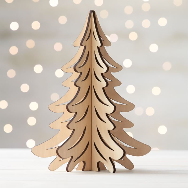 Graphic wood trees are laser-cut in realistic detail, easily assembled into dimensional, freestanding conversation pieces. Large tree with a natural finish can be paired with our laser-cut animals and village for a full decorative statement.<br /><br /><NEWTAG/><ul><li>Laser-cut plywood</li><li>Natural finish</li><li>3 pieces</li><li>Stores flat</li><li>For decorative use only; not a toy</li><li>Made in China</li></ul>